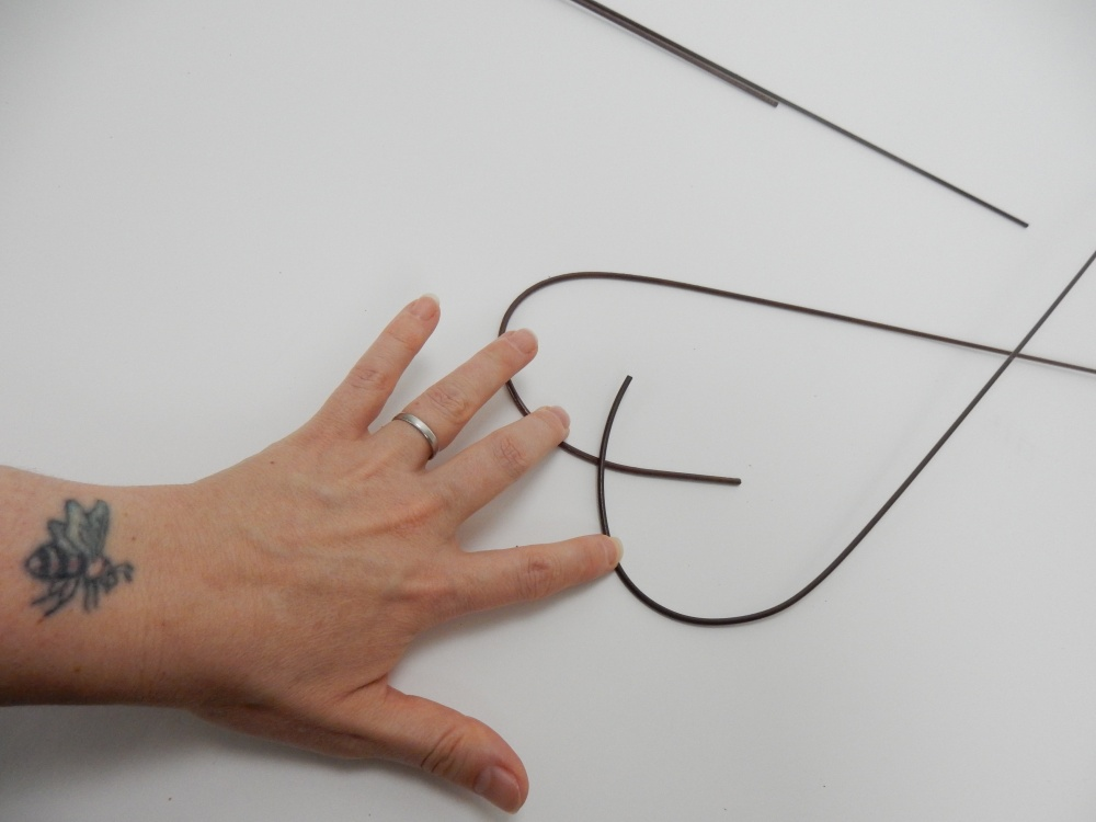Bend two sturdy wires into a heart shape.