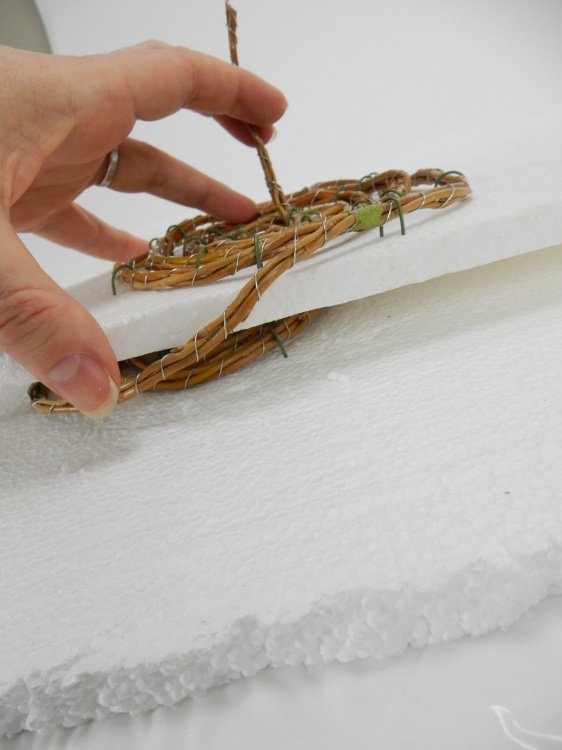 Place the two Styroofoam sheets on top of each other and set aside for the twigs to dry