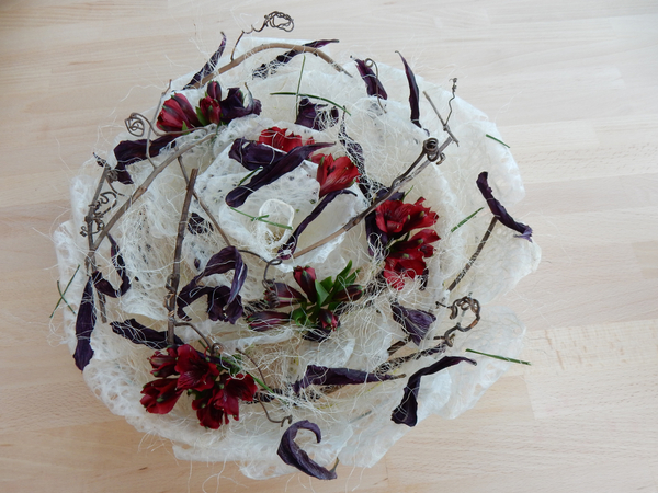 Grape vine tendrils, alstroemeria, and dried lily petals inj a Waski rose armature