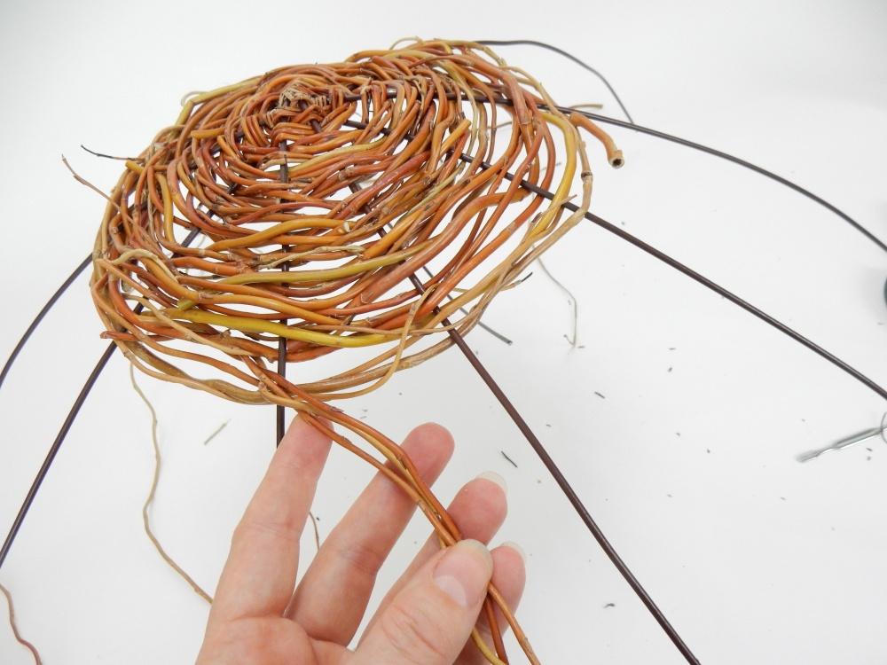 Weave thin willow stems through the wires in to create a dense spiral around the binding point.