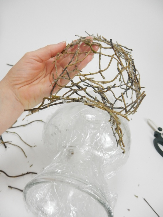 Lift the first half of the twig vase away and set it aside