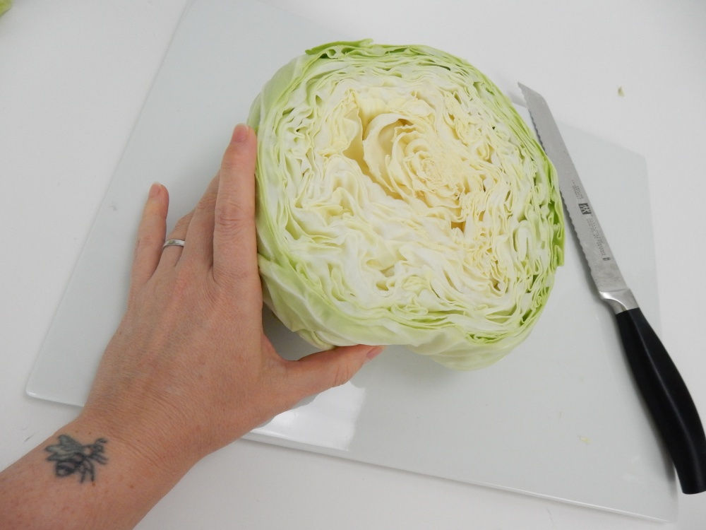 Slice a chunk away from the cabbage