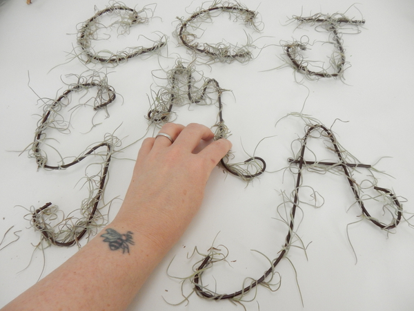 Wrap the letter with a strand of Spanish Moss