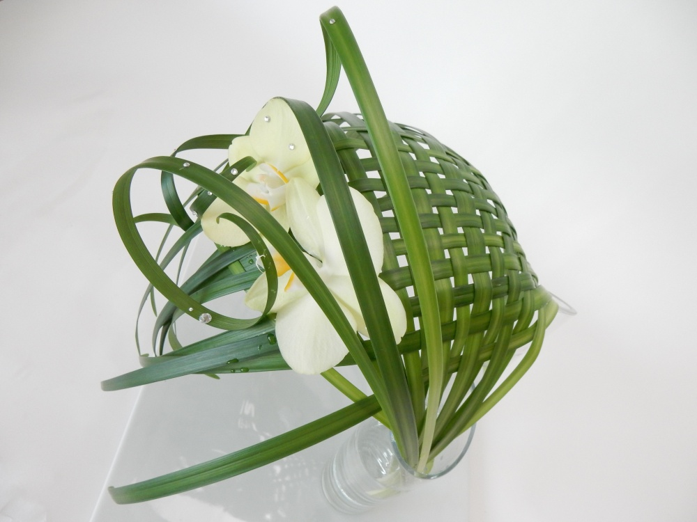 Woven lily grass in two water filled vases