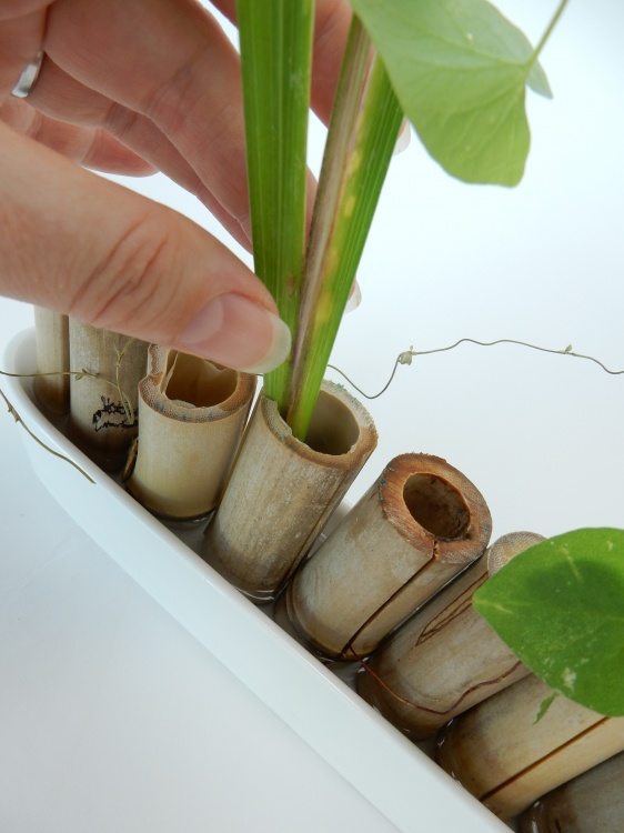 Keep the pieces in place by sliding it into any split parts of the bamboo