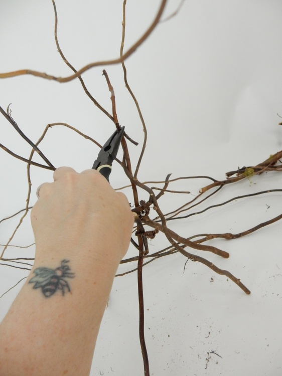Twist the wire around the twigs in a figure eight to secure