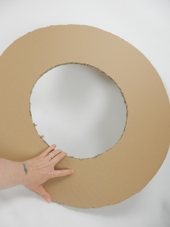 Cut a large circle out of cardboard