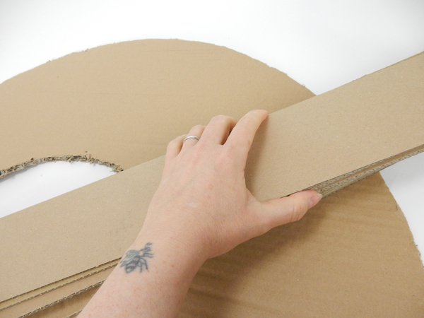 Cut strips of cardboard as thick as you want the wreath to be