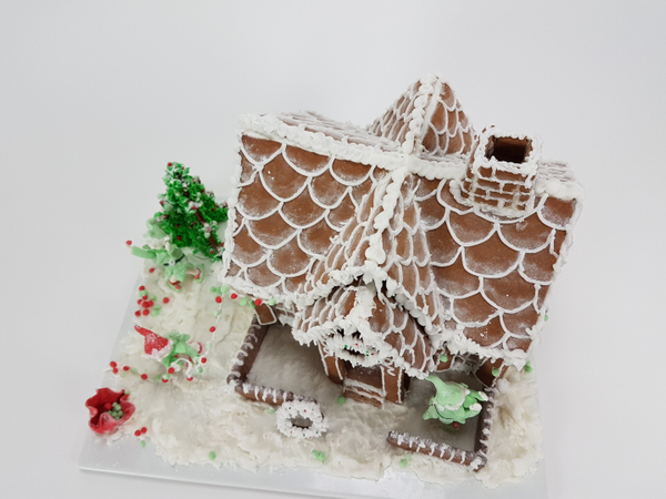 Fresh frosting on the gingerbread house