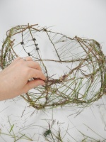 Weaving grass to create a delicate mesh cup armature