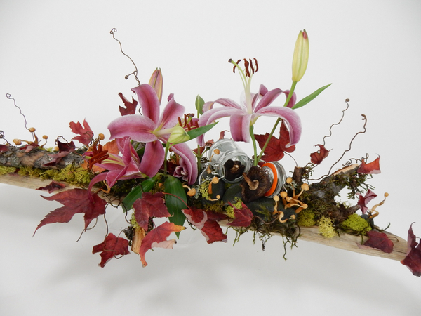 Lilies, moss, autumn leaves and mushroom design