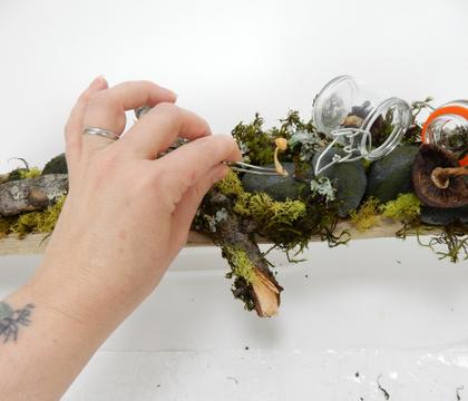 Driftwood base for a floral foam pebble design