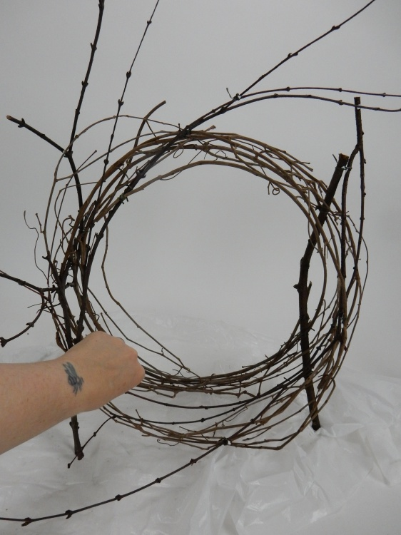 Snip away any stems that keep a vine wreath in place and loosen up the coils
