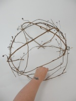 Cut a vine wreath into sections to create a cup shaped armature