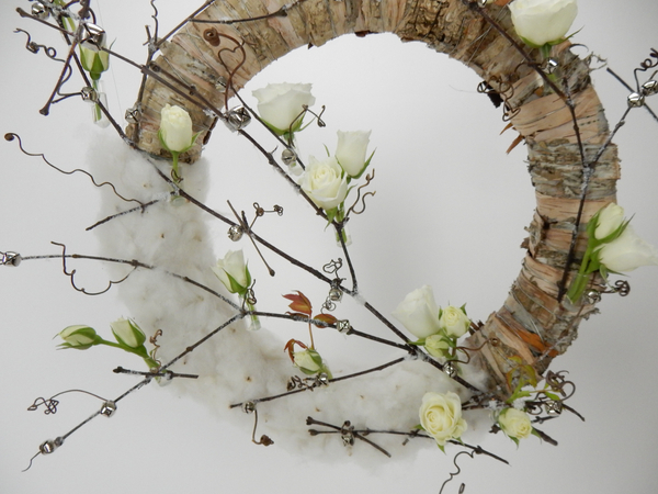Add tiny silver bells to the wreath design