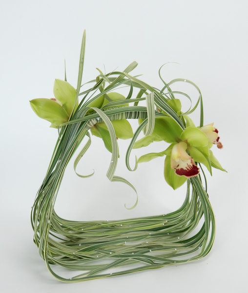 Cymbidium orchids and curled grass with crystals