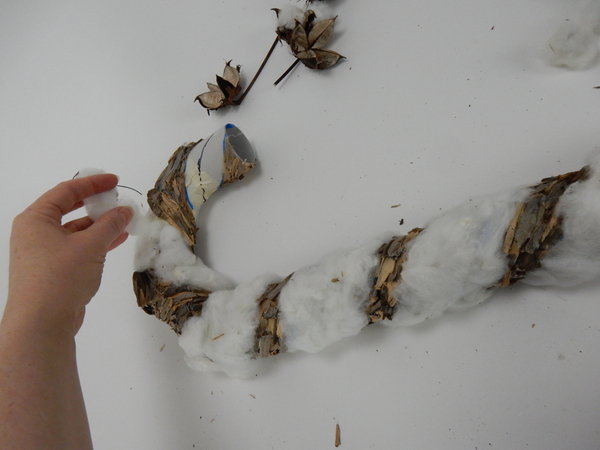 Glue the cotton fluff to cover the open candy cane strip
