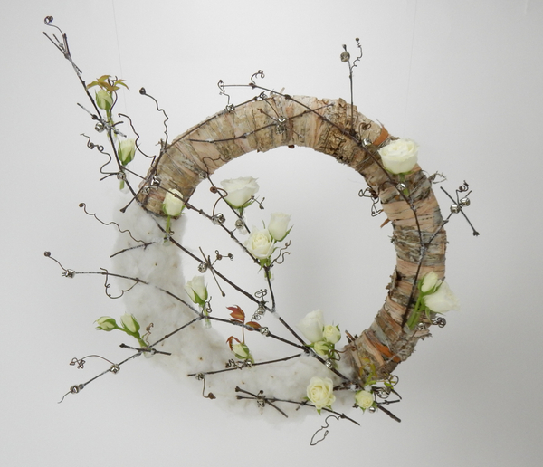 Jingle bell, vine, roses cotton and bark wreath.