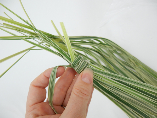 Wrap the stems with a blade of grass to create a neat handle
