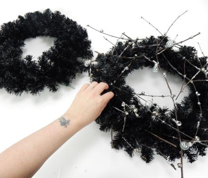 Glue floral details into an artificial wreath frame