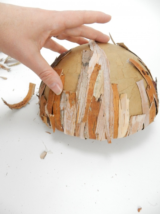 Turn the shape around and glue strips of bark to the underside
