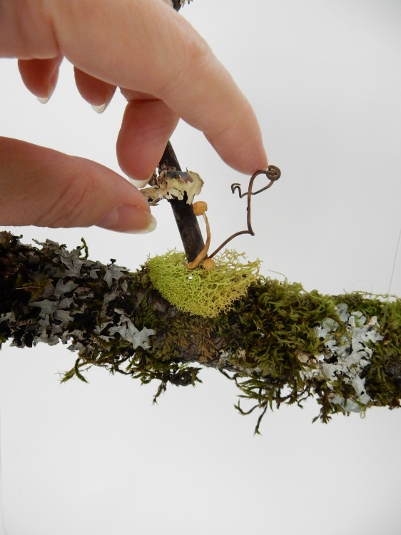 Glue in bits of reindeer moss, dried mushrooms and grape vine tendrils.