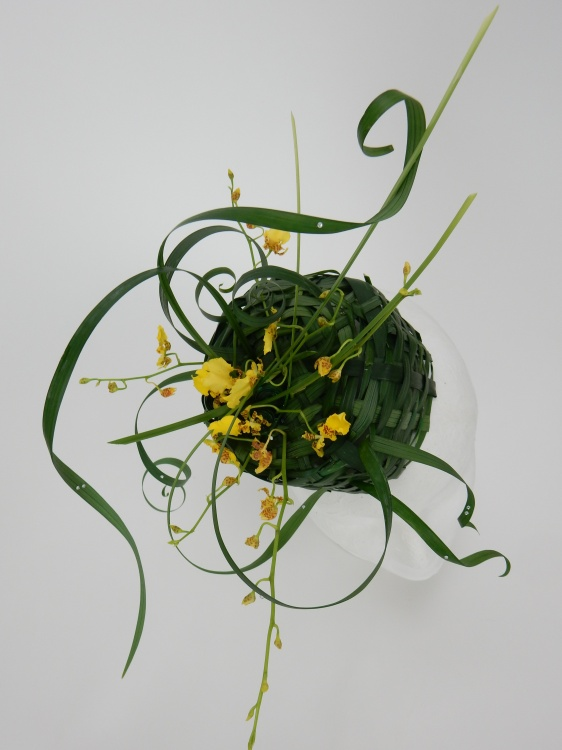 Easter bonnet woven from lily grass with oncidium orchids