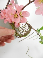 A little nest for Easter chocolates that naturally hooks over the edge of a container