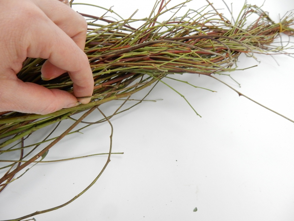 Hook your finger around individual twigs to pull it from the braid