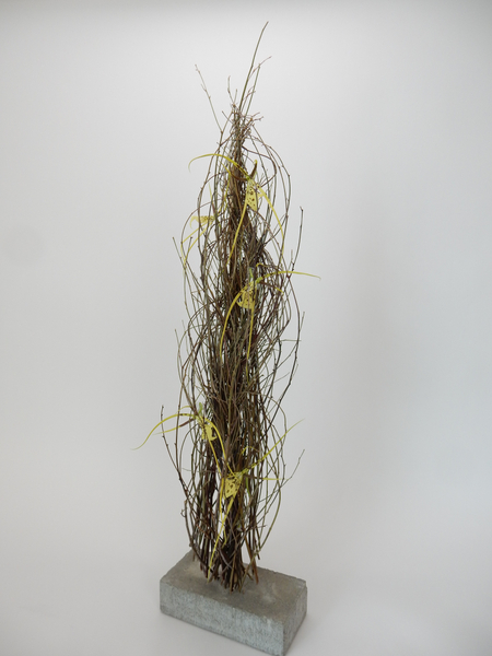 Twig braid with dancing Brassia orchid