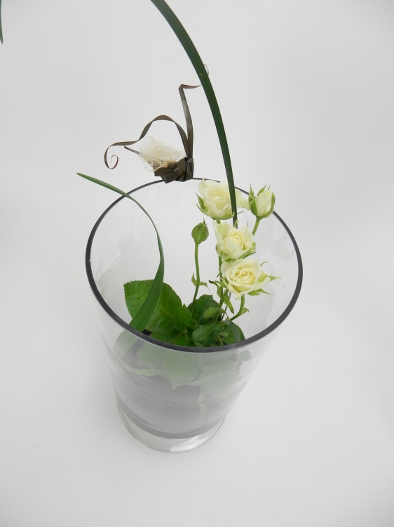 Set roses in a vase with a Kenzan