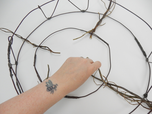 Glue the twigs so that it radiates out from a central point
