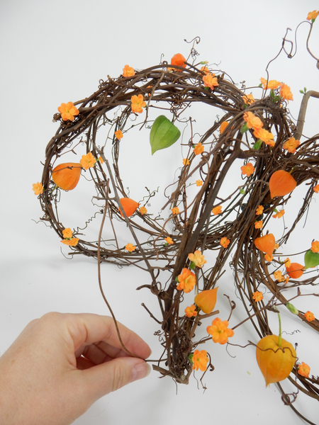 Add in a few more tendrils and vine to help your eye fill in the picture of the pumpkin