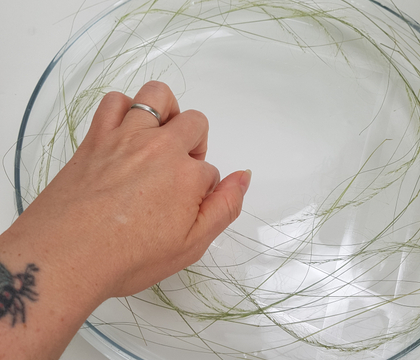 Tape a grid around the edges of a container for a table top wreath