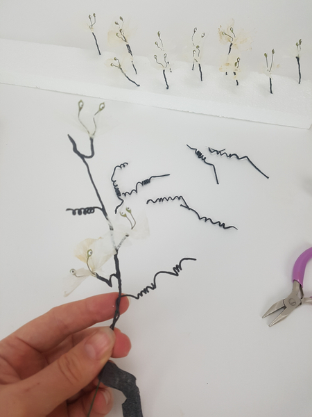 Carefully tape the tendrils and blossoms to the stem wire
