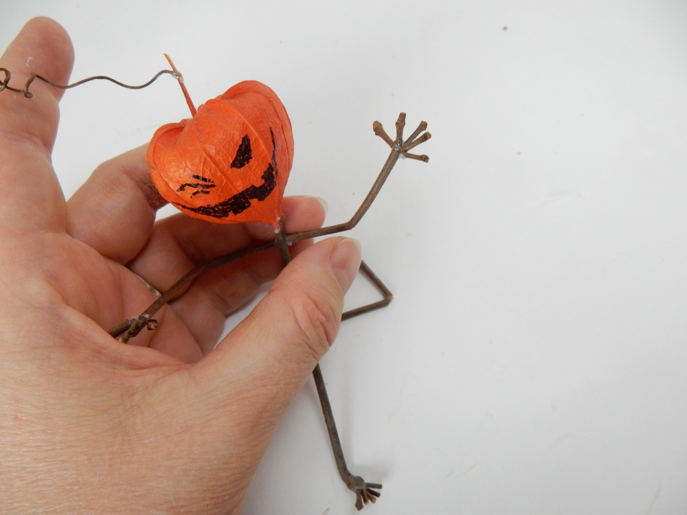 Glue the arms and legs to a twig body