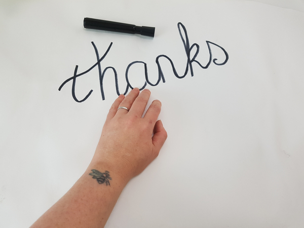 Write your message on a flat working surface with a marker.