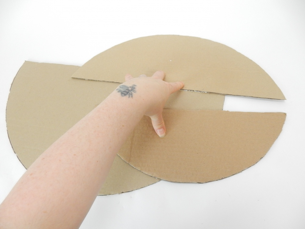 Place the cardboard circles on a flat work surface