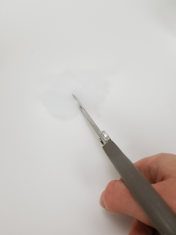 Cut into the disk from the edge to the mid point