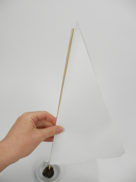 Fold a piece of paper in half and measure it against the dowel