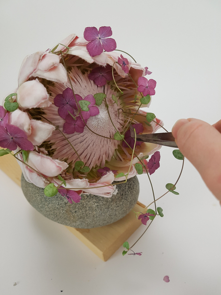 Place the Hydrangea florets into the flower head