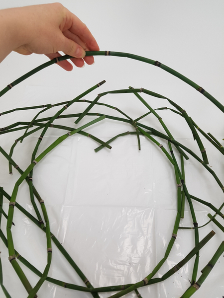 Stack the curved stems to create a wreath shape