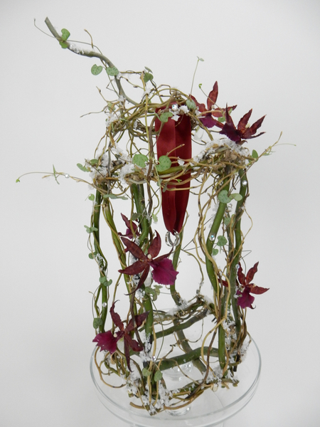 Willow and orchid flower arrangement