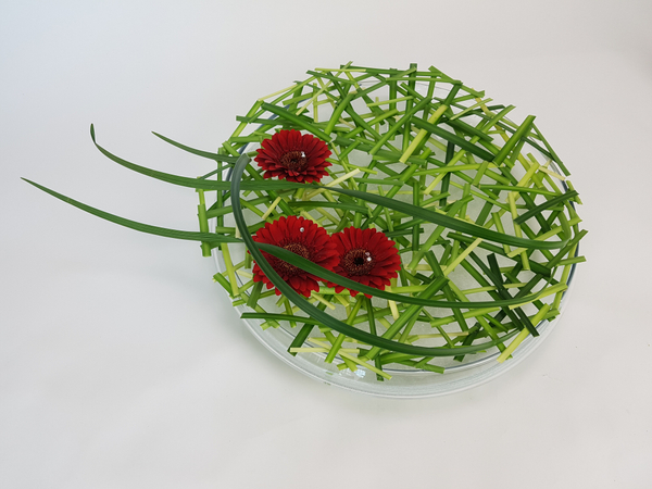 Lily grass and gerbera floral design