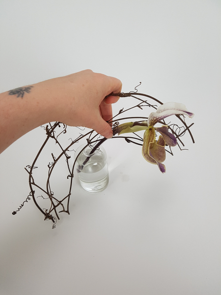 Weave the orchid stem through the armature