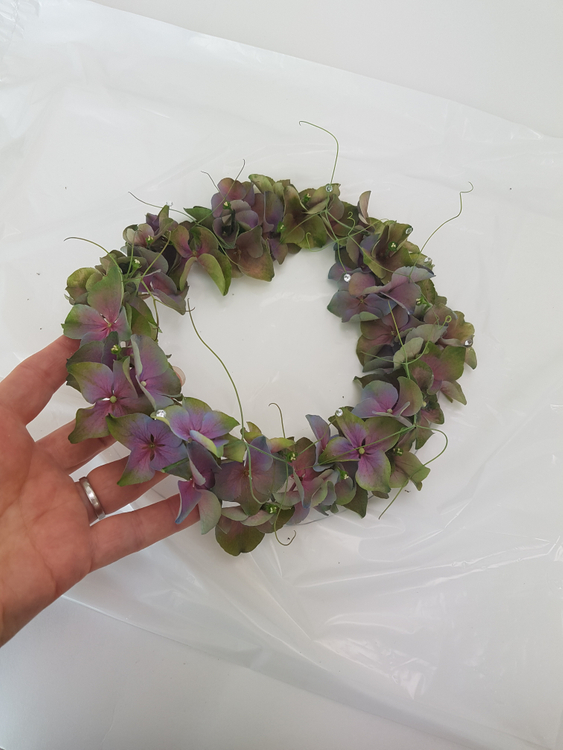 Gently lift the hydrangea wreath from the plastic