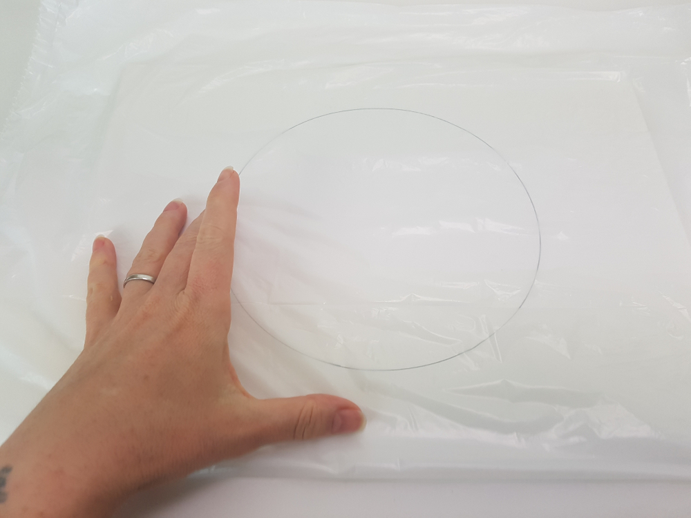 This makes it easier to lift the delicate floral float in case some glue sticks to the surface, it would be stuck to the plastic and can be peeled away.
