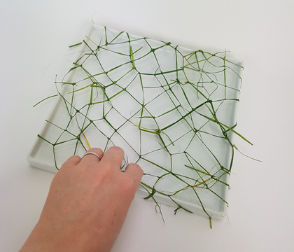 Wrap around grass loop and knot armature