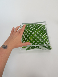 Tuck a loosely woven grass grid into a square container