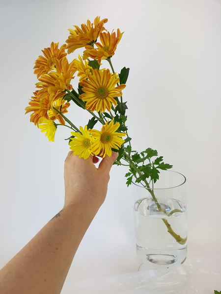 Place the flower stem at an angle in a vase